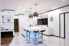 kitchen island hood chromed spherical pendant lamps blue light infused modern kitchen