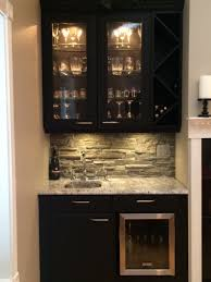 how to build an outdoor movie projector screen cheap remodeling kitchen wall interior using faux stone panel with grey and white backsplash combined black wooden
