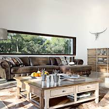 Rustic Living Room With Brown Leather Couch And Distressed Wood - Leather sofa design living room