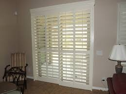 sliding glass door with the plantation shutters closed but the