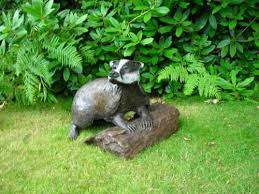 sculpture into the moonlight playful size badger