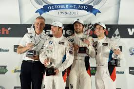victory bmw bmw team rll celebrates victory at the petit le mans bill