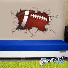 football breaking through bursting shattering wall decal