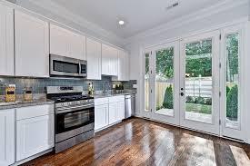 White Kitchen Glass Backsplash Kitchen Shiny And Glossy Glass Backsplash Idea For Clean Kitchen