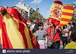 anti independence catalan protestors carry spanish flags and