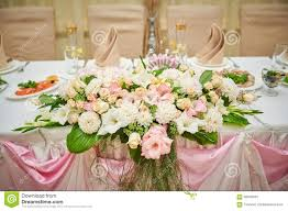home decoration with flowers wedding table bride and groom decorated with flowers stock photo