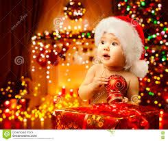 baby christmas christmas baby opening present happy kid santa hat gift
