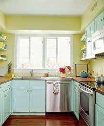 alluring turquoise kitchen theme mixed with two tones flooring