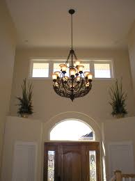 interior high ceiling foyer lighting with windows glass door and