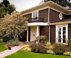 dark brown house exterior traditional with white pillars white