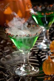 halloween drinks closeup of witch blood martini vodka gin vermouth and liquor