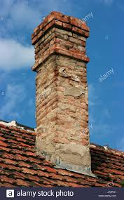 vintage brick chimney drainpipe chimney flue red blue house