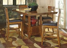 We Have Affordable Dining Room Sets From Trusted Furniture Brands - Hyland counter height dining room table with 4 24 barstools