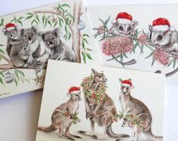 australian christmas card with koala family mum dad child