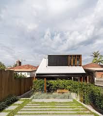 budget family home in sydney uses reclaimed bricks concrete and tile