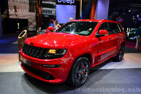 red jeep 2016 jeep grand cherokee srt red vapor front three quarters at the 2014