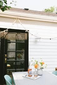 jojotastic diy macrame cafe lights for your patio or deck twisted macrame rope and antiqued bells dress up simple cafe lights for a cool boho