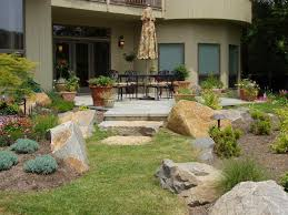 cream wall hardscape patios design backyard that has grey concrete