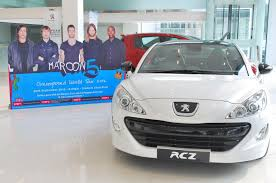 peugeot car showroom peugeot promotes maroon 5 concert offers backstage passes