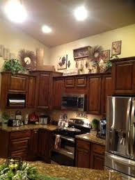 decorating ideas for kitchen cabinet tops above cabinet decor kitchen decorations cabinet
