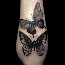 black work butterfly on the forearm butterfly