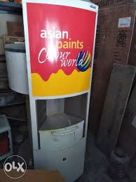 white asian paints colour world cabinet machin or with pant