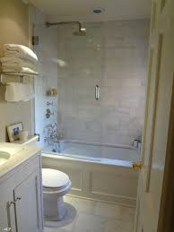 tiled shower larger tiles less grout less yuck marble idea for when we remodel our guest bathroom love the bathtub rain showerhead glass door it feels open even though it s a small bathroom