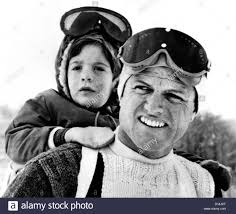ted kennedy gives his nephew john f kennedy jr a piggy back ride