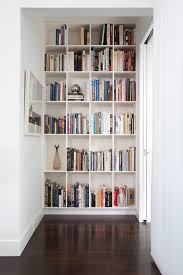 transitional decorative books with wall decor hall transitional