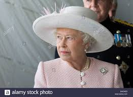 hm queen elizabeth ii wearing a pink jacket and white wide brim