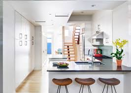 narrow brooklyn townhouse gets sleek revamp for family of four a sunny open living room and kitchen on the first floor are joined via wood and steel staircase to the second master suite and third kids bedrooms