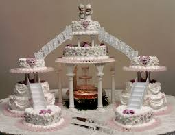 wedding cakes with fountains and lights decorating of party
