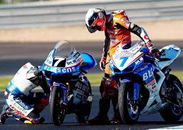 aprilia motocross bike an aprilia 125cc gp bike next to a