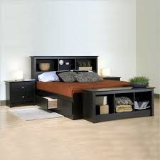 bedroom with black furniture including bed frame with drawers