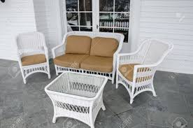 White Wicker Patio Furniture - white wicker patio furniture set out to relax and enjoy the view
