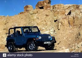 jeep wrangler ads jeep wrangler october 1997 blue metallic alloy wheels stock photo
