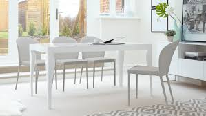 6 seater white gloss dining table and stackable dining chairs