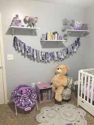purple and grey nursery with elephants seeing sunshine