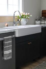 how to organize the sink cabinet organizing the kitchen sink the wood grain cottage