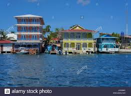 colorful waterfront colonial houses over the sea with boats at