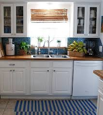 white cabinets with butcher block countertops cabinets blue backsplash butcher block countersbutcher beadboard