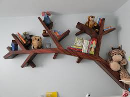 tree branch bookshelf 2 500 00 via etsy woodland nursery