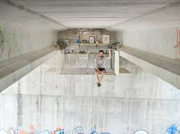 picture studio fernando abellanas creates secret studio a bridge in valencia