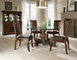 interesting round glass dining table set with cream floor and