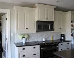 granite countertop white kitchen cabinets green walls
