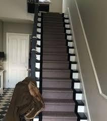 grey carpet stair runner on dark wood stairs beautiful stair
