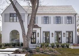 Painting Brick Exterior House - white house gray shutters transitional home exterior domino