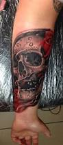 forearm skull tattoos sugar skull with red rose forearm tattoo by razvan popescu