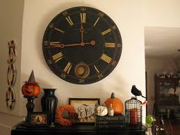 tiny halloween interior decorating under big roman wall clock