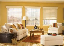 decorating yellow wall with glass window and white faux wood